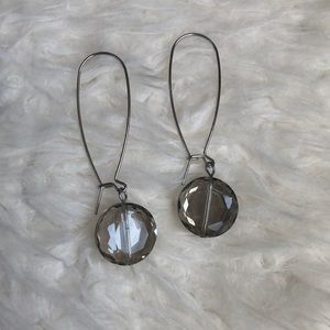 Silver dangling earrings with grey-ish crystals